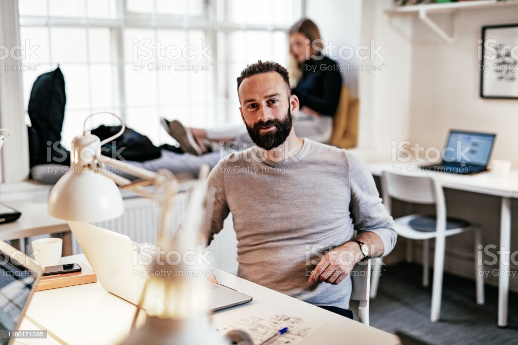 Modern Entrepreneur Working On Laptop In Office Stock Photo - Download Image Now - iStock