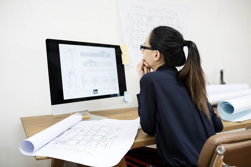 Businesswoman working in office - business computers documents indoor  office paper people woman work worked works… | Business women, Business  stock photos, Business
