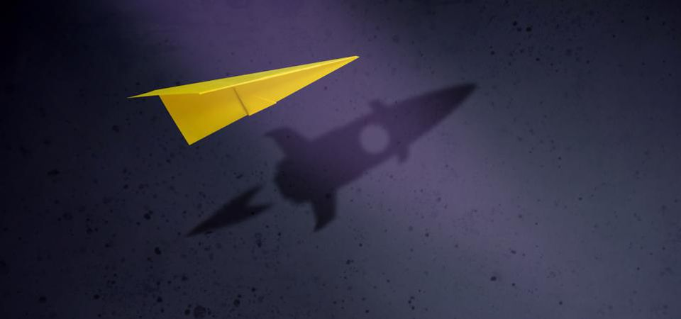 Paper Plane Flying with Shadow of Rocket